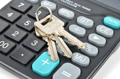 Calculator and key Stock Photo
