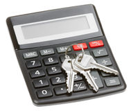 Calculator with a key isolated Stock Images