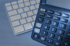 Calculator and keyboard Stock Photo