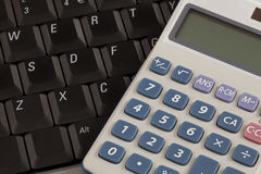 Calculator and Laptop Royalty Free Stock Images