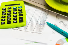 Calculator,laptop and cup of coffee on the financial documents Stock Image