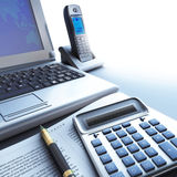 Calculator, laptop and pen with financial document. S in blue colors Royalty Free Stock Photos