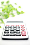 Calculator and leaf stock photos