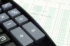 Calculator and Ledger Paper Royalty Free Stock Image