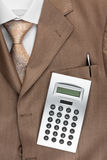 Calculator lies on the suit Royalty Free Stock Photos