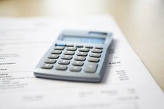 Calculator lying on telephone bill close-up Royalty Free Stock Photo