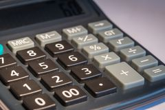 Calculator macro photo. Close of calculator to symbolise mathematics and education. Taken on white background Stock Images