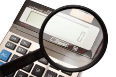 Calculator with magnifier. Electronic calculator which displays zero with magnifier Stock Image