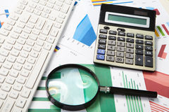 Calculator and magnifier Royalty Free Stock Photos