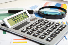 Calculator and magnifier Royalty Free Stock Photography