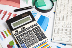 Calculator and magnifier Stock Images
