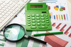 Calculator and magnifier Stock Photos
