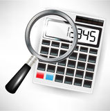 Calculator and magnifying glass Royalty Free Stock Image