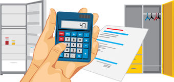 Calculator in a male hand on a background of an empty refrigerator and a wardrobe Stock Photo