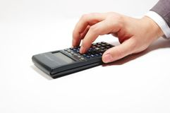 Calculator_man. Man making calculations Stock Photography