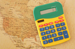 Calculator with map of America Royalty Free Stock Photo