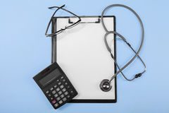 Calculator with medical clipboard stock images