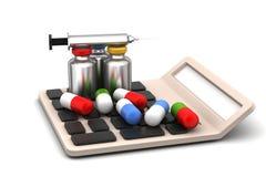 Calculator with medicines Stock Photo