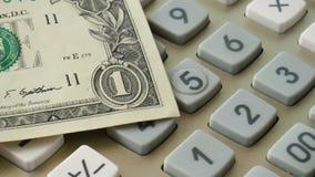 Calculator met dollar stock videobeelden