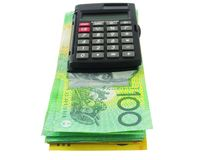 Calculator met geld Stock Fotografie