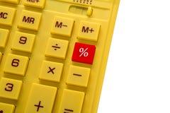 Calculator met rode knoop met achtergrond Stock Foto's