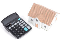 Calculator and model house Stock Image