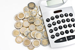 Calculator with money. Calculator with euro coins isolated on a white background Stock Photography