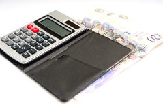 Calculator and money. Photograph of electric calculator and money Stock Photos