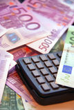 Calculator and money. Calculating commission - calculator and money (EURO Royalty Free Stock Photos