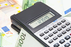 Calculator and money. Background on the economy with calculator and money Royalty Free Stock Photos