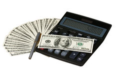 Calculator and money. Calculator on heap of dollars isolated on a white background Stock Photo