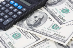 Calculator on money american hundred dollar bills Royalty Free Stock Photos