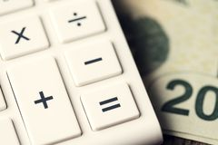 Calculator Money Bill Twenty Plus. Shallow depth of field. Selective focus on equal button Royalty Free Stock Photography