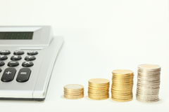 Calculator and money coin Stock Photography