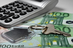 Calculator, money and house key Royalty Free Stock Image