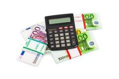 Calculator and money Royalty Free Stock Photos