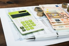 Calculator with money over financial sheet Stock Photos