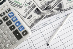 Calculator, money and pen Stock Photography