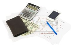 Calculator, money, phone, wallet on papers Stock Photo