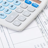 Calculator with monthly utility bill under it - close up shot Stock Photos