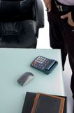 Calculator and mouse on desk Royalty Free Stock Images