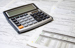 Calculator And Newspaper Stock Image