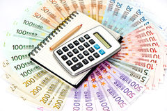 Calculator and note book. euro banknotes Royalty Free Stock Images