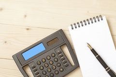 Calculator and note book on  table Royalty Free Stock Photo