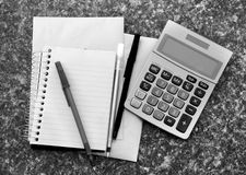 Calculator with note pad Royalty Free Stock Photography