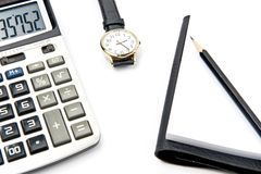 Calculator note pad and watch Stock Photo