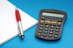 Calculator noteblok and a pen Royalty Free Stock Image