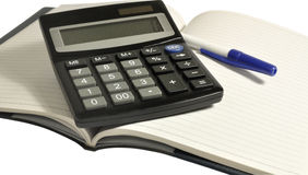 calculator on notebook Stock Photography