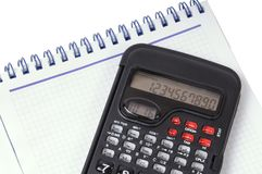Calculator and notebook Stock Photos
