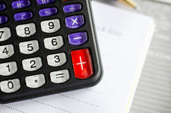 Calculator with notebook Stock Photo